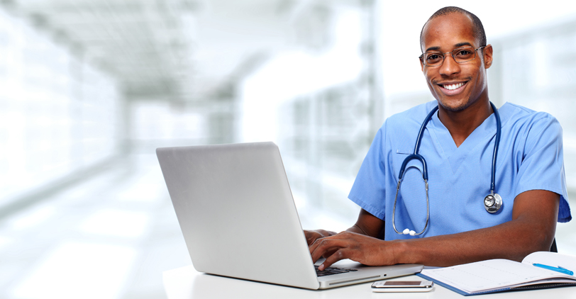 A medical professional on laptop