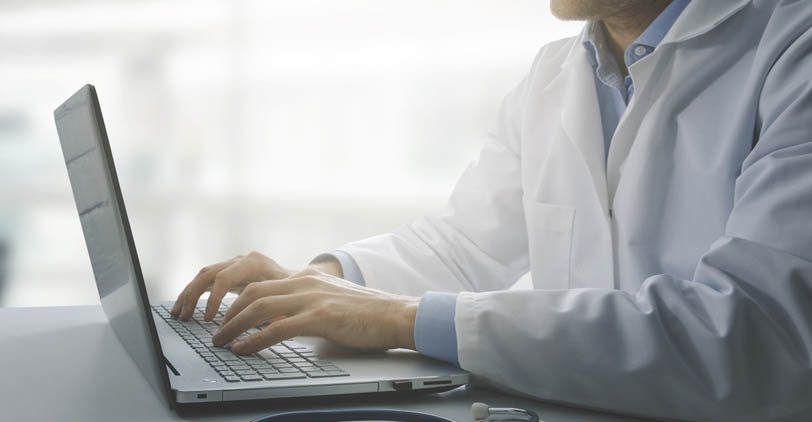 A medical professional using electronic claims filing