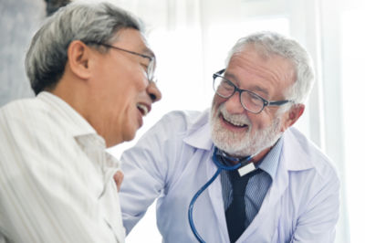Doctor and patient laughing