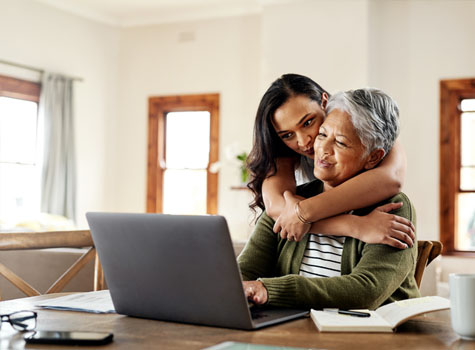 A senior woman on a fixed income taking advantage of her member discounts, with her daughter's help.