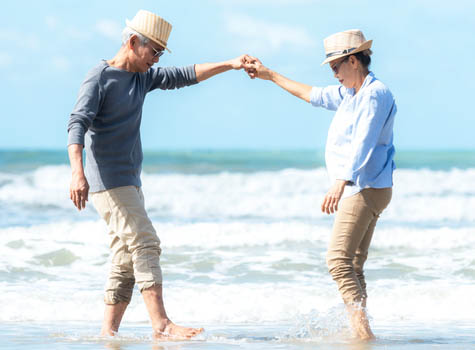 Senior couple dancing on a beach