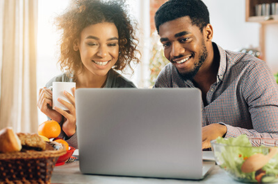 Man and women looking at laptop together