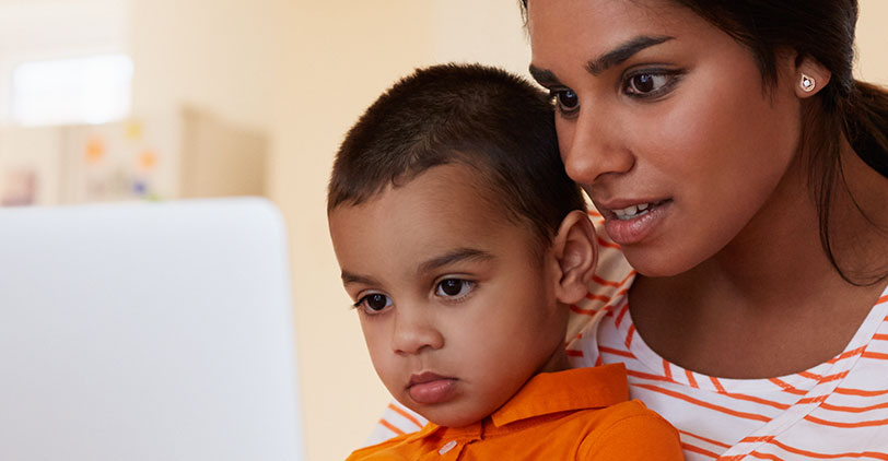 Mother and child using a laptop
